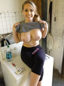 maggie showing her gorgeous tits while waiting for her laundry